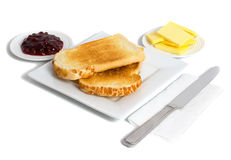 Toast and Jam on white background. Fresh toast served with jam and butter isolated on white background Stock Images