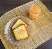 Toast with juice. Toast with juice on a straw napkin Royalty Free Stock Photography
