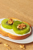 Toast with kiwi, cheese and walnuts Stock Photography