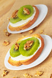 Toast with kiwi, cheese and walnuts Royalty Free Stock Image
