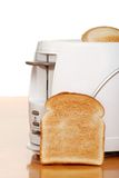 Toast leaning on toaster Stock Photography