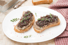 Toast with liver pate, caramelized onion, thyme Stock Photos