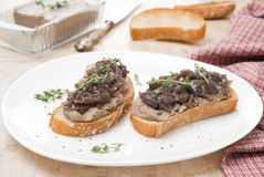 Toast with liver pate and caramelized red onion Royalty Free Stock Photography