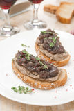 Toast with liver pate, caramelized red onion and thyme, vertical Royalty Free Stock Images