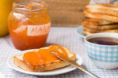 Toast with marmalade Royalty Free Stock Photos