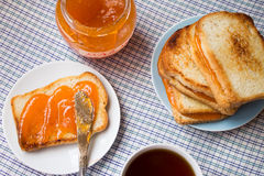 Toast with marmalade Stock Image