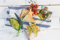 Toast with mashed avocado, olive oil and tomato Royalty Free Stock Photo