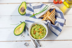 Toast with mashed avocado, olive oil and tomato Stock Image