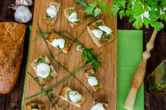 Toast with mozzarella, olive oil, herbs and garlic Royalty Free Stock Images