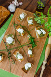 Toast with mozzarella, olive oil, herbs and garlic Royalty Free Stock Photos