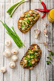 Toast with mushrooms and fried chicken, sprinkled with Toast with mushrooms and fried chicken Royalty Free Stock Image