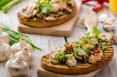 Toast with mushrooms and fried chicken, sprinkled with Toast with mushrooms and fried chicken Stock Photos