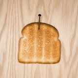 Toast nailed to wood. Stock Photo