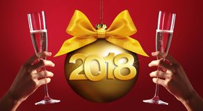Toast New Year`s Eve, hands with glass of sparkle wine on red ba. Ckground with christmas ball and 2018 text Royalty Free Stock Photo