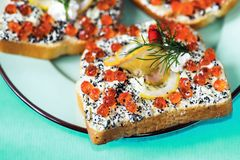Toast with orange and black caviar,butter, lemon and dill Stock Photos