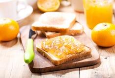 Toast with orange mandarin marmalade with fresh fruits Stock Photography