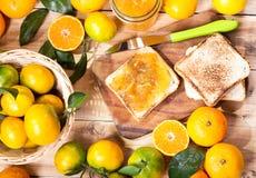 Toast with orange mandarin marmalade with fresh fruits Royalty Free Stock Photography