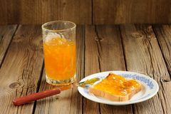 Toast with orange marmalade on wooden background Stock Images