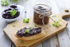 Toast with paste from black olives and basil Royalty Free Stock Image