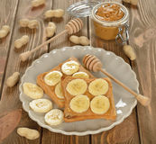 Toast with peanut butter and banana Royalty Free Stock Images