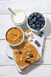 Toast with peanut butter and blueberry, top view. Vertical Stock Images