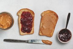 Toast with peanut butter and jam Stock Images