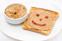 Toast with peanut butter and a painted smile Stock Images