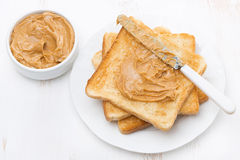 Toast with peanut butter on a plate, top view. Horizontal Stock Photo