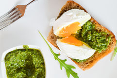 Toast with pesto and with egg Royalty Free Stock Photography