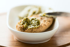 Toast with pesto sauce in bowl on wood Royalty Free Stock Photography