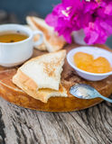 Toast with pineapple jam and tea. Breakfast Rustic Stock Image