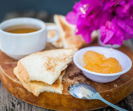 Toast with pineapple jam and tea. Breakfast Rustic Stock Images