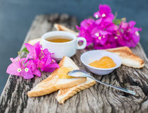 Toast with pineapple jam and tea. Breakfast Rustic Stock Photos