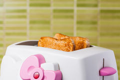 Toast and pink Toaster Royalty Free Stock Image