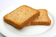 Toast on a plate 02. Toast on a white plate Stock Images