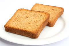 Toast on a plate 03. Toast on a white plate Stock Photo