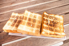 Toast on a plate. On a wooden table Stock Image