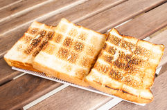 Toast on a plate. On a wooden table Stock Photos