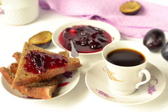 Toast with plum jam and coffee Stock Images