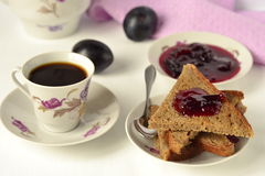 Toast with plum jam and coffee Stock Photography