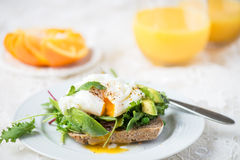 Toast and Poached Egg with Green Salad, Avocado and Peas Royalty Free Stock Images