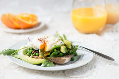 Toast and Poached Egg with Green Salad, Avocado and Peas Stock Images