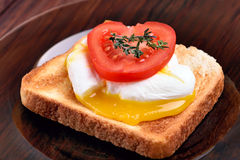 Toast with poached egg and tomato Stock Photos