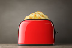 Toast popping out of Vintage Red Toaster. 3d Rendering Royalty Free Stock Image
