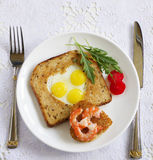 Toast with quail eggs in the form Royalty Free Stock Images