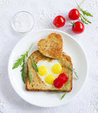 Toast with quail eggs in the form Royalty Free Stock Photos
