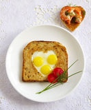 Toast with quail eggs in the form Royalty Free Stock Image