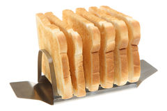 Toast in Rack. Six slices of toast in a modern stainless steel toast rack Royalty Free Stock Photography