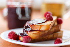 Toast with raspberry jam Stock Photo