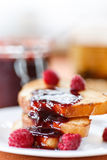 Toast with raspberry jam Royalty Free Stock Photos